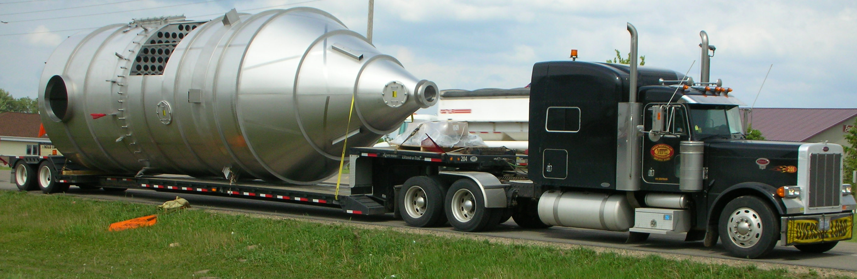 Truck carrying an oversized load with an oversized truck permit